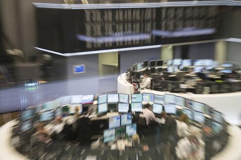 Germany, Frankfurt on the Main, People working in stock exchange (defocused) - NH01087