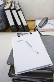 Workplace, Clipboard and ballpen placed on folders - JRF00110