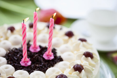 Black forest cake with candles, close-up - MAEF01738