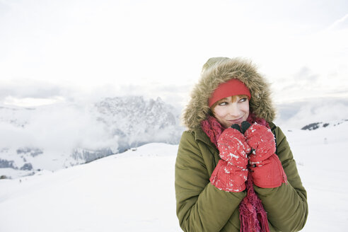 Italy, South Tyrol, Seiseralm, Woman in snowy landscape, portrait - WEST11648