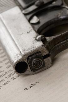 Antique Pistol lying on book - AWD00378