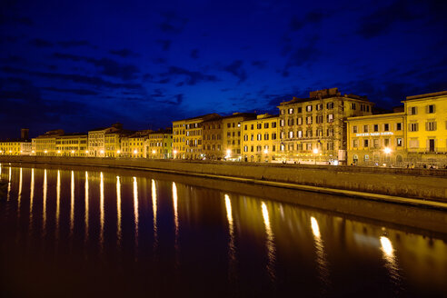 Italy, Tuscany, Pisa, Arno river, lighted buildings at night - PSF00265