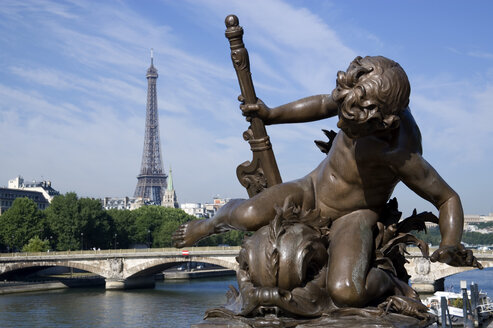 France, Paris, Pont Alexandre III, Bronze statue, Eiffel Tower in background - PSF00190