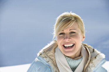 Italy, South Tyrol, Seiseralm, Portrait of a woman, laughing, close-up - WESTF11409
