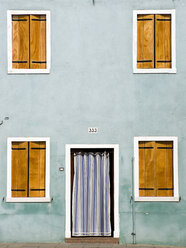 Italy, Venice, Burano, House facade, closed shutters, Front door with curtain - PSF00313