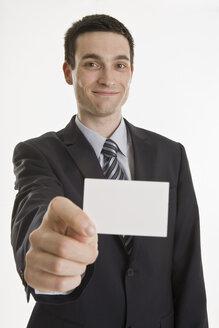 Businessman holding blank business card - LDF00737