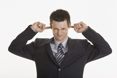 Businessman closing his ears with fingers - LDF00734