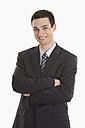 Businessman arms crossed, smiling, portrait - LDF00725