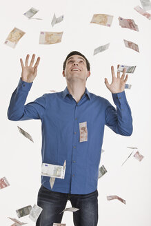 Businessman, Euro notes flying in air - LDF00707