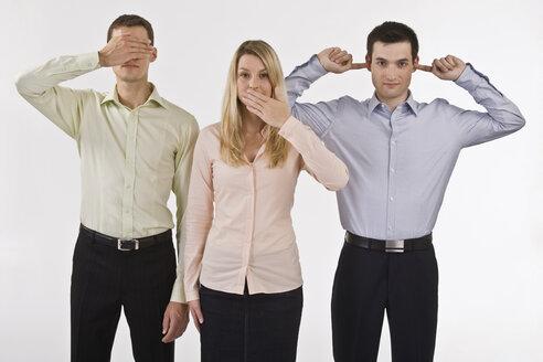 Business people gesturing see no evil, hear no evil, speak no evil - LDF00768