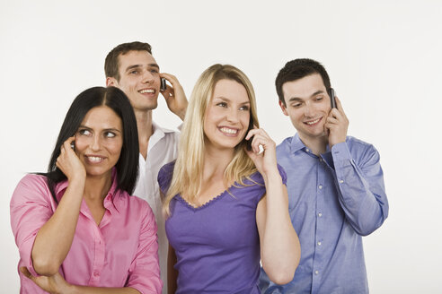 Four persons using mobile phone - LDF00738