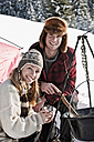 Austria, Salzburger Land, Couple cooking on campfire - HHF03044