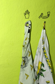 Towels hanging from hook on green wall - AWDF00399