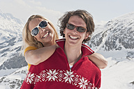 Austria, Salzburger Land, Young couple smiling, portrait, close-up - HHF03069