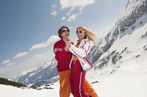 Austria, Salzburger Land, Couple dancing, laughing, portrait - HHF03063