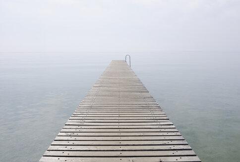 Italy, Jetty on Lake Garda in mist - RUEF00314