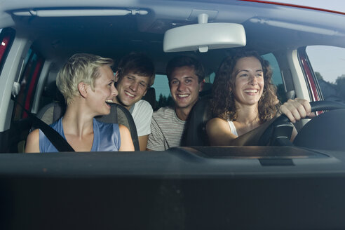 Germany, Bavaria, Young people driving car, smiling, portrait - LDF00807