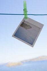 Greece, Lesvos, Polaroid hanging on clothesline - JRF00133