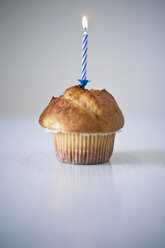 Muffin with lit candle - JRF00127