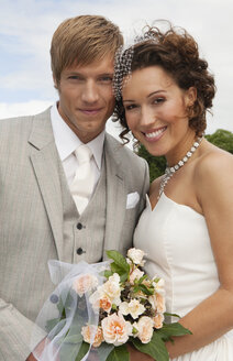 Germany, Bavaria, Portrait of groom and bride, outdoors, close-up - NHF01138