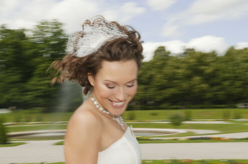 Germany, Bavaria, Bride in park, smiling, portrait, close-up - NHF01126