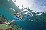 Croatia, Two girls (6-7) (10-11) snorkeling, portrait - GNF01171