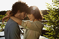 Germany, Berlin, Spree river, Young Couple embracing, side view, portrait - VVF00083