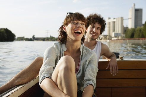 Germany, Berlin, Young couple on motor boat, laughing, portrait - VVF00074