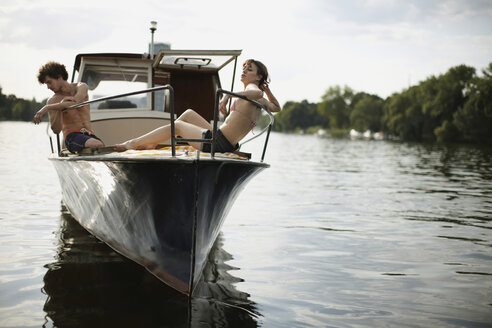 Germany, Berlin, Young couple on motor boat - VVF00068
