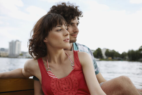 Germany, Berlin, Young couple on motorboat, portrait - VVF00050