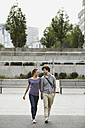 Germany, Berlin, Young couple holding hands - VVF00026