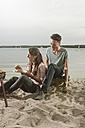 Germany, Berlin, Lake Wannsee, Young couple having a barbecue - WESTF13975