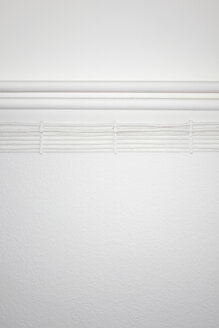 Pipes and electric cables on white wall - TLF00378