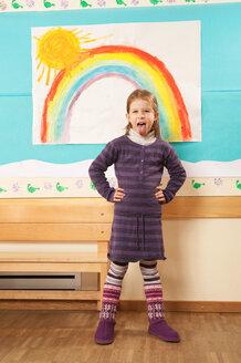 Germany, Portrait of a girl (4-5) in nursery, hands on hips - RNF00140