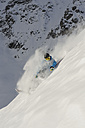 Italy, South Tyrol, Sulden, Man skiing downhill - MIRF00036