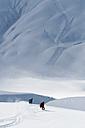 Austria, Arlberg, Two men skiing downhill - MIRF00018