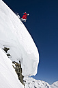 Austria, Salzburger Land, Gerlos, Skier jumping from Mountain, side view, elevated view - FFF01110