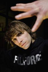 Man gesturing, portrait, close up. - PKF00358