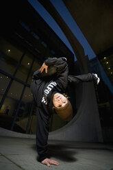 Man performing break dancing, portrait. - PKF00355