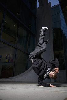 Man performing break dancing, portrait. - PKF00352