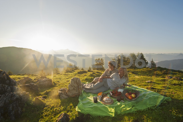 Young couple lying on blanket, looking at view. - HHF03214