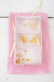 Candied lemon twist in rack on wax paper - COF00137