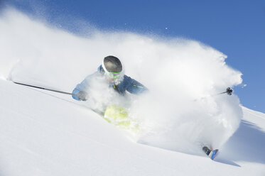 Austria, Man skiing on arlberg mountain - MIRF00059