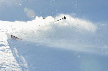 Austria, Man skiing on arlberg mountain - MIRF00056