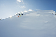 Austria, Man skiing on snow covered arlberg mountain - MIRF00053