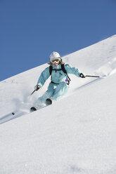 Austria, Woman skiing on arlberg mountain, smiling - MIRF00050