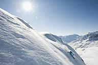 Austria, Woman skiing on arlberg mountain - MIRF00047