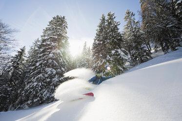 Germany, Man skiing on herzogstand mountain - MIRF00041