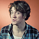 Man making funny faces and pouting, portrait - WVF00030