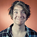 Man pulling funny faces, portrait - WVF00027